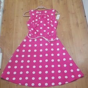 Pink and white polka dot dress.